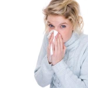 woman sneezing because of pests