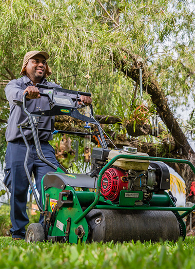 A One Two Tree lawn care specialist.